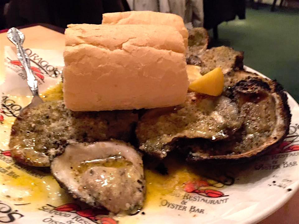 Drago's charbroiled oysters with bread for sopping up the garlic butter goodness.